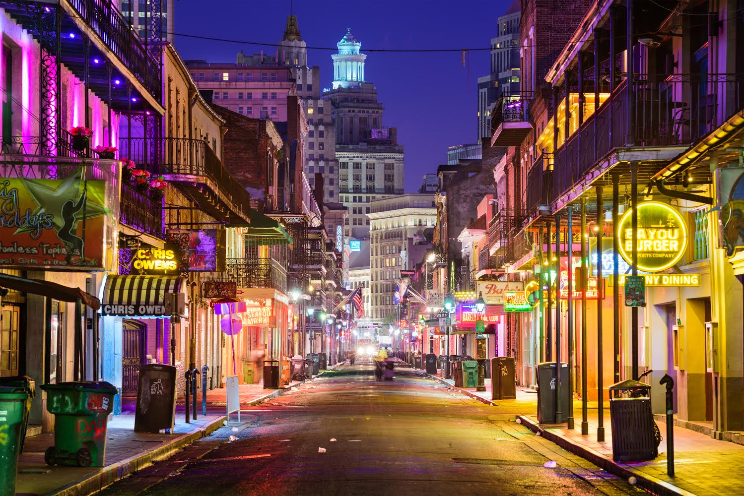 New Orleans, LA, USA - May 10, 2016: Neon bar signs line Bourbon Street in the early morning. The renown nightlife destination is in the heart of the French Quarter.